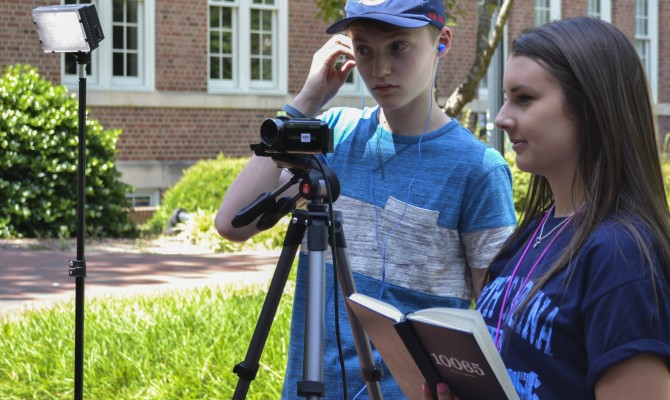 Workshop: West Johnson High junior Hannah Creech and TC Roberson sophomore Dillon McDowell work on a broadcast package together on June 14, 2016. They are preparing to interview a peer on the subject of the 75th anniversary of NCSMA. Credit: Caroline Bowers; TC Roberson High School